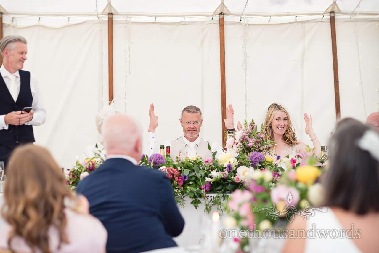 Bride and groom react to best mans speech at Countryside Manor House Wedding