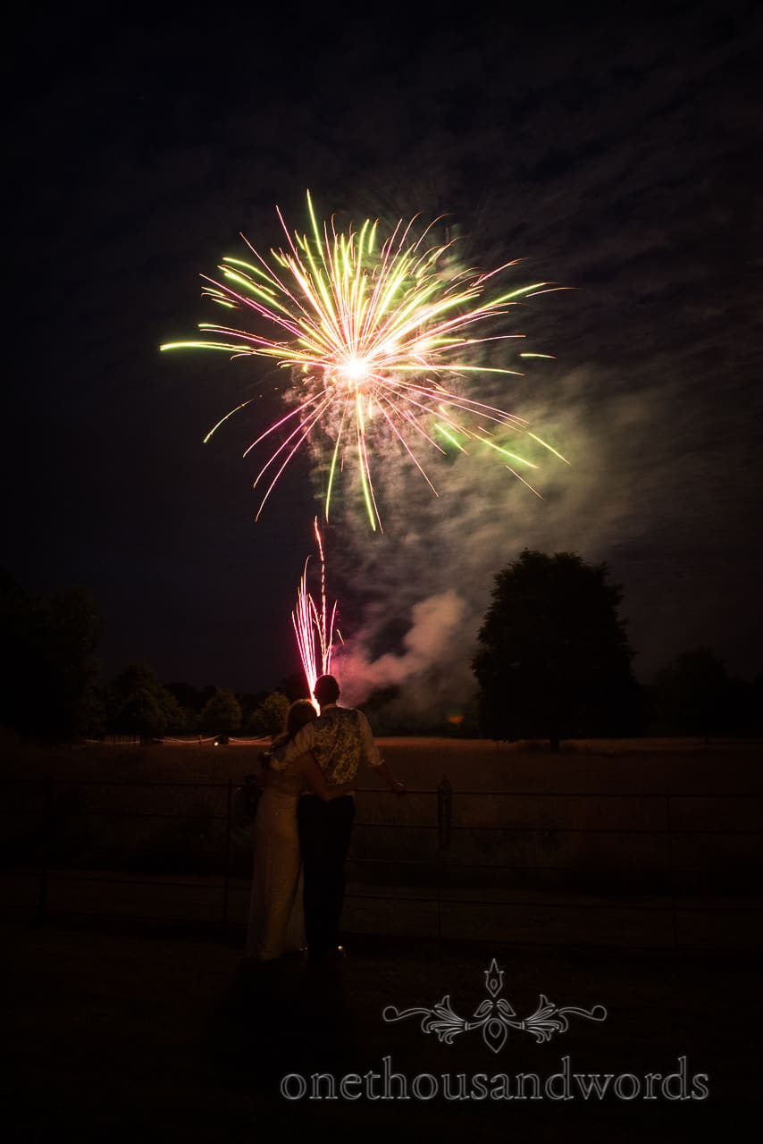 Bride and groom with fireworks from Countryside Manor House Wedding