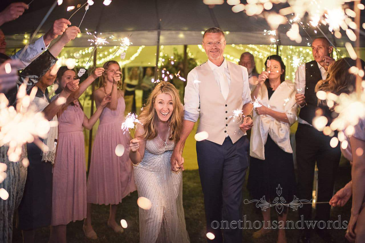 Bride and groom with sparklers at countryside manor house wedding