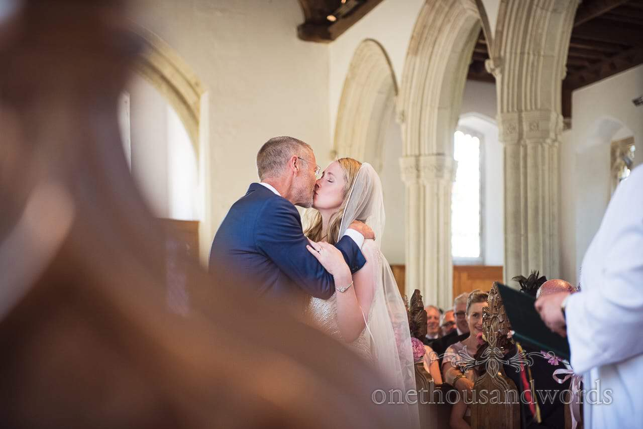 Bride and grooms first kiss from Countryside Manor House Wedding