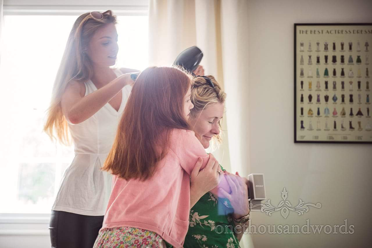 Bride has hair styled before Countryside Manor House Wedding