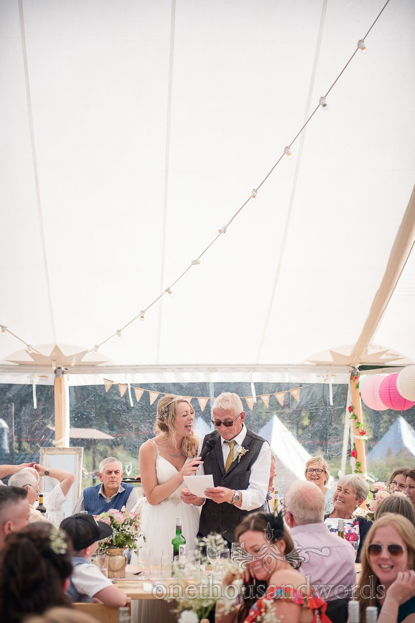 Bride helps father with speech from Purbeck Valley Farm Wedding Photographs
