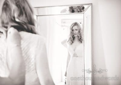 Bride in vintage wedding dress in mirror from Countryside Manor House Wedding