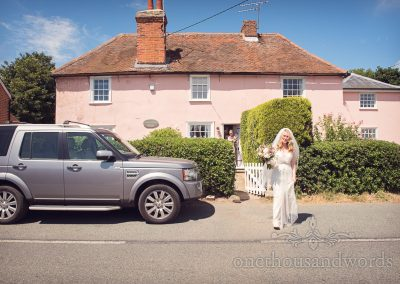 Bride outside home on morning of Countryside Manor House Wedding