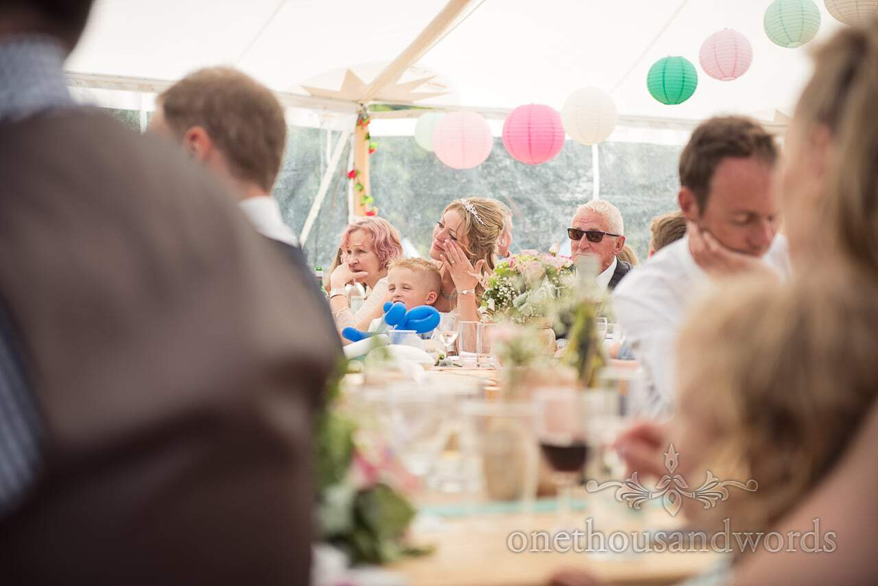 Bride reaction during speeches Purbeck Valley Farm Wedding Photographs