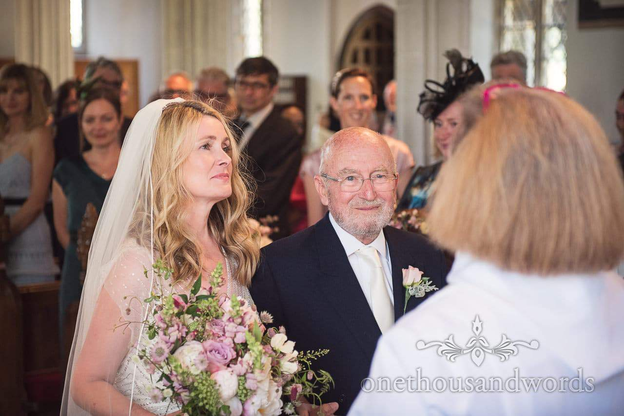 Bride with father in church from Countryside Manor House Wedding
