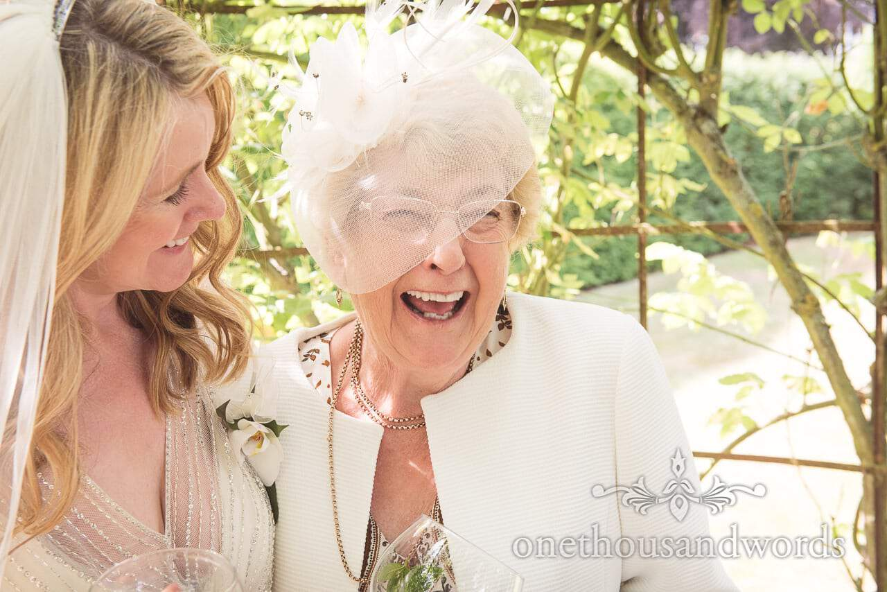 Bride with mother in garden at countryside wedding