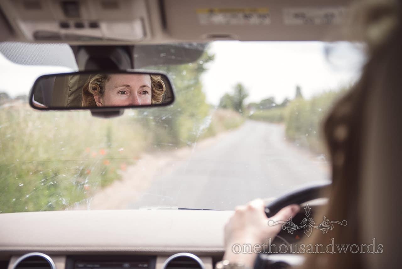 Brides eyes in rear view mirror on wedding morning
