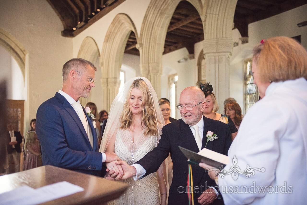 Brides hand in marriage is given away by father at Countryside Manor House Wedding