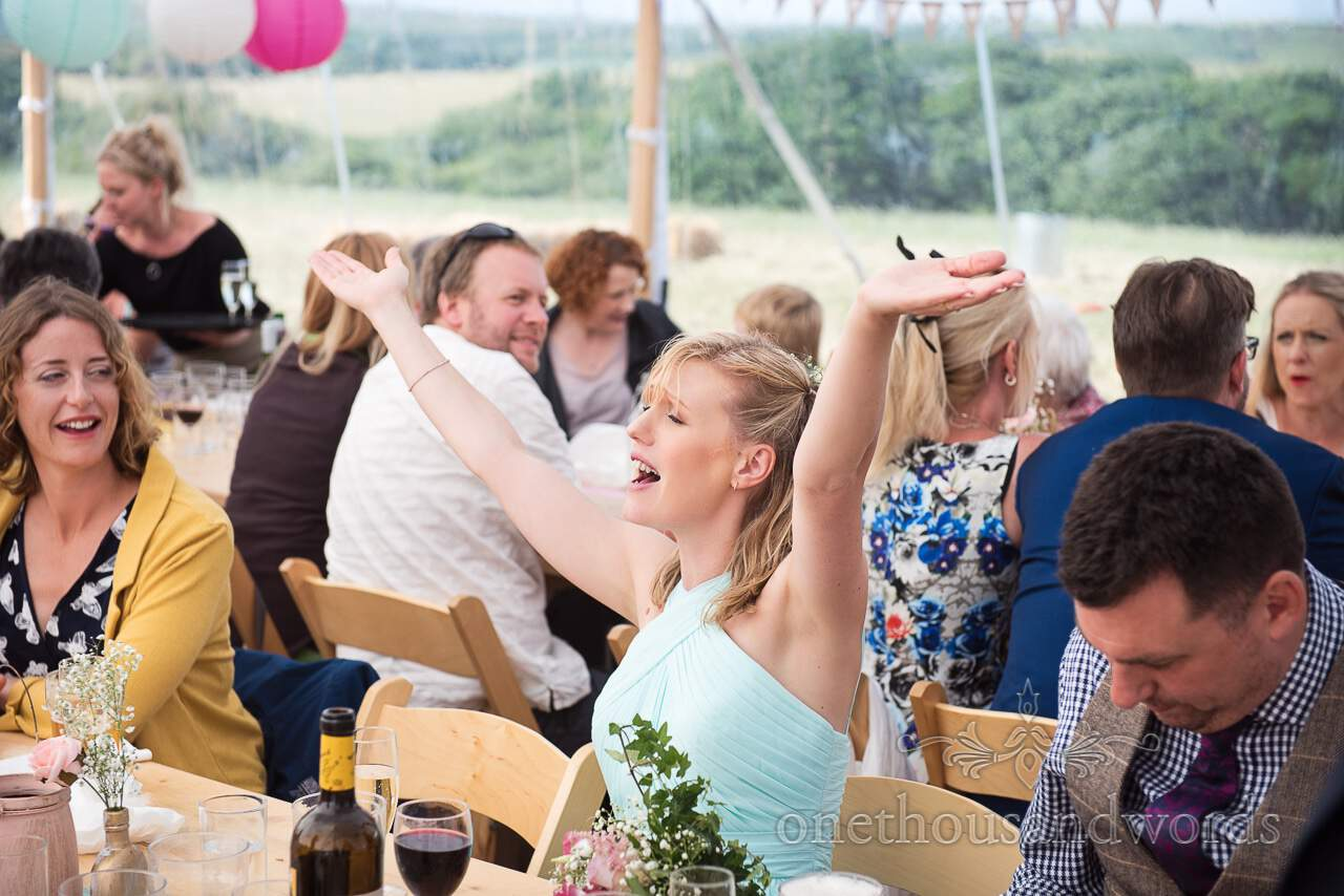 Bridesmaid breaks out into song during wedding breakfast at marquee wedding