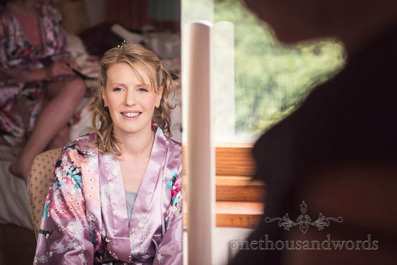 Bridesmaid has hair and make up styled from Purbeck Valley Farm Wedding Photographs