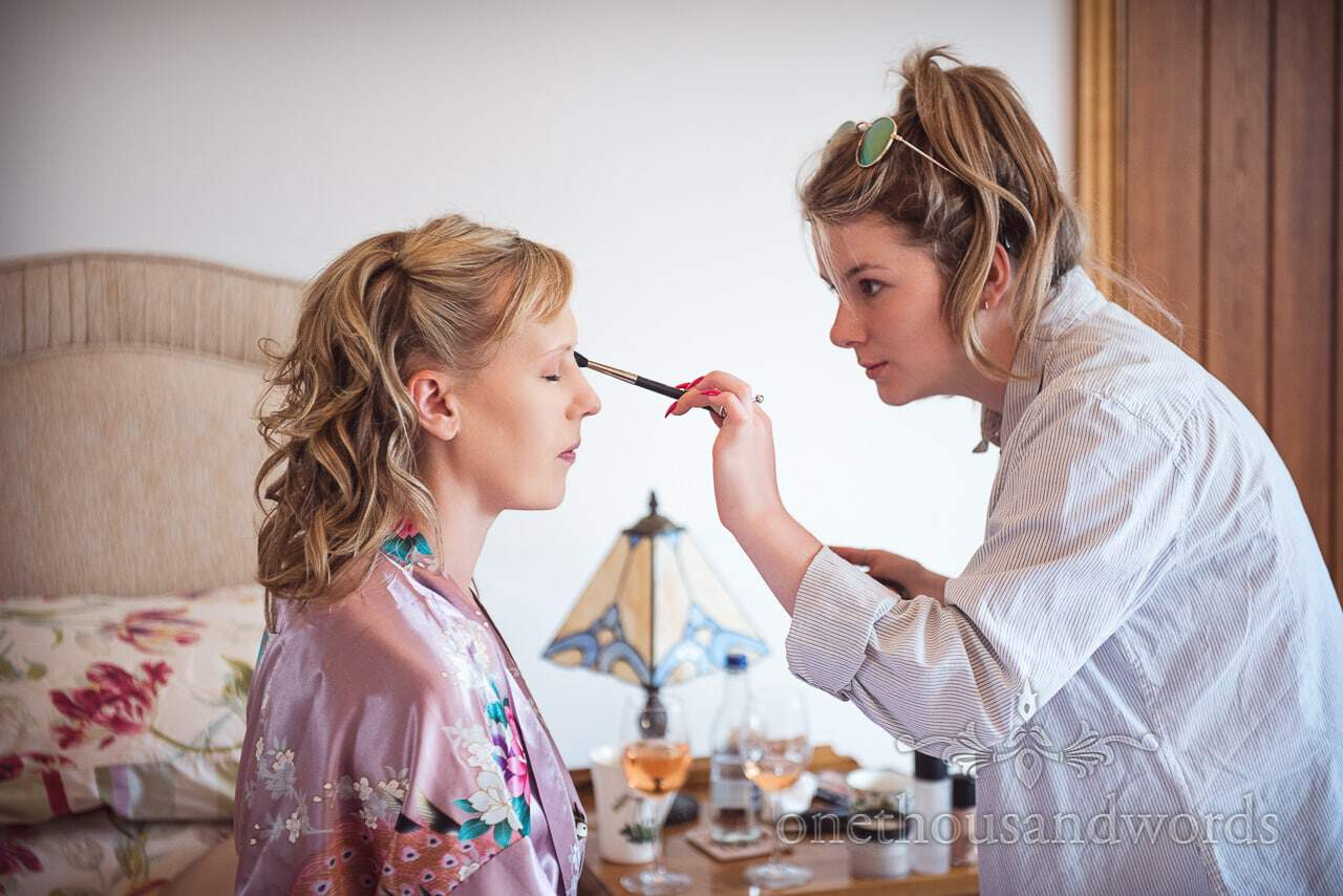 Bridesmaid has make up styled on morning of Purbeck Valley Farm Wedding Photographs