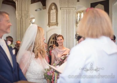 Bridesmaid looks on at church Countryside Wedding
