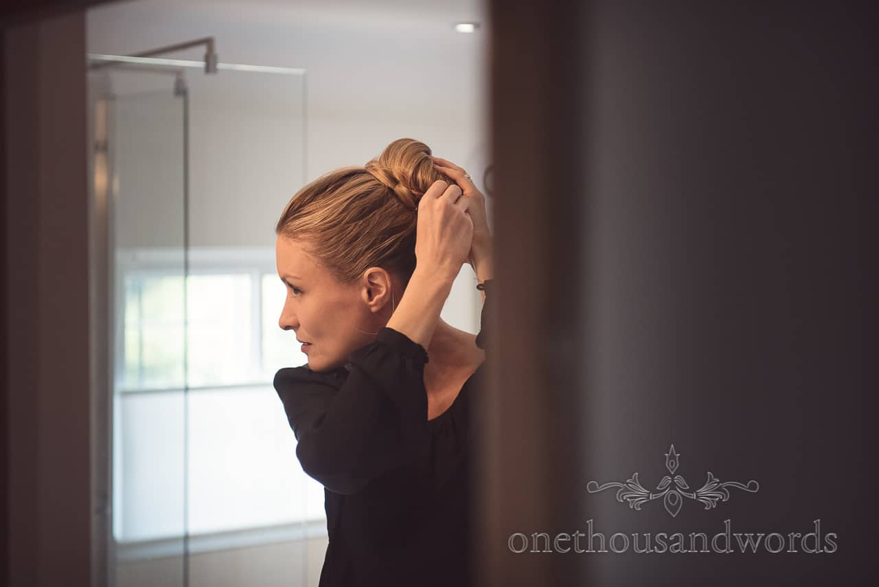 Bridesmaid putting hair up for Countryside Manor House Wedding