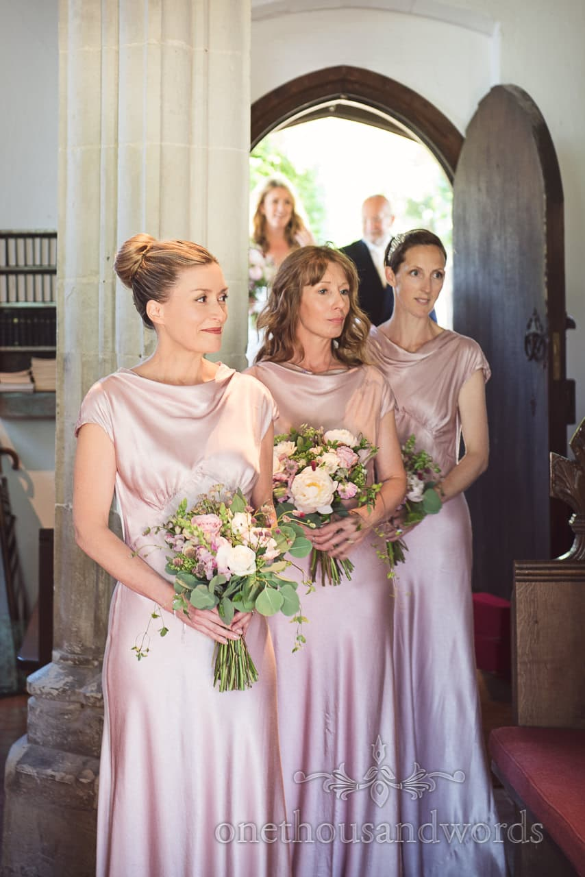 Bridesmaids led wedding party into church from Countryside Wedding