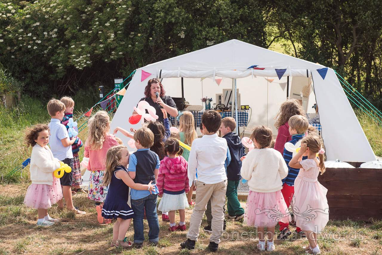 Children are entertained at Purbeck Valley Farm Wedding Photographs