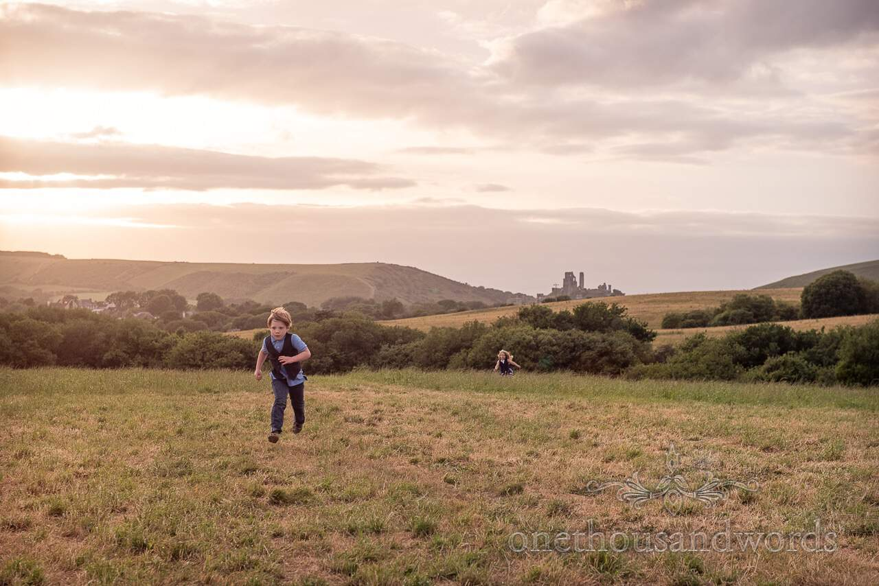 Children play in field from Purbeck Valley Farm Wedding Photographs