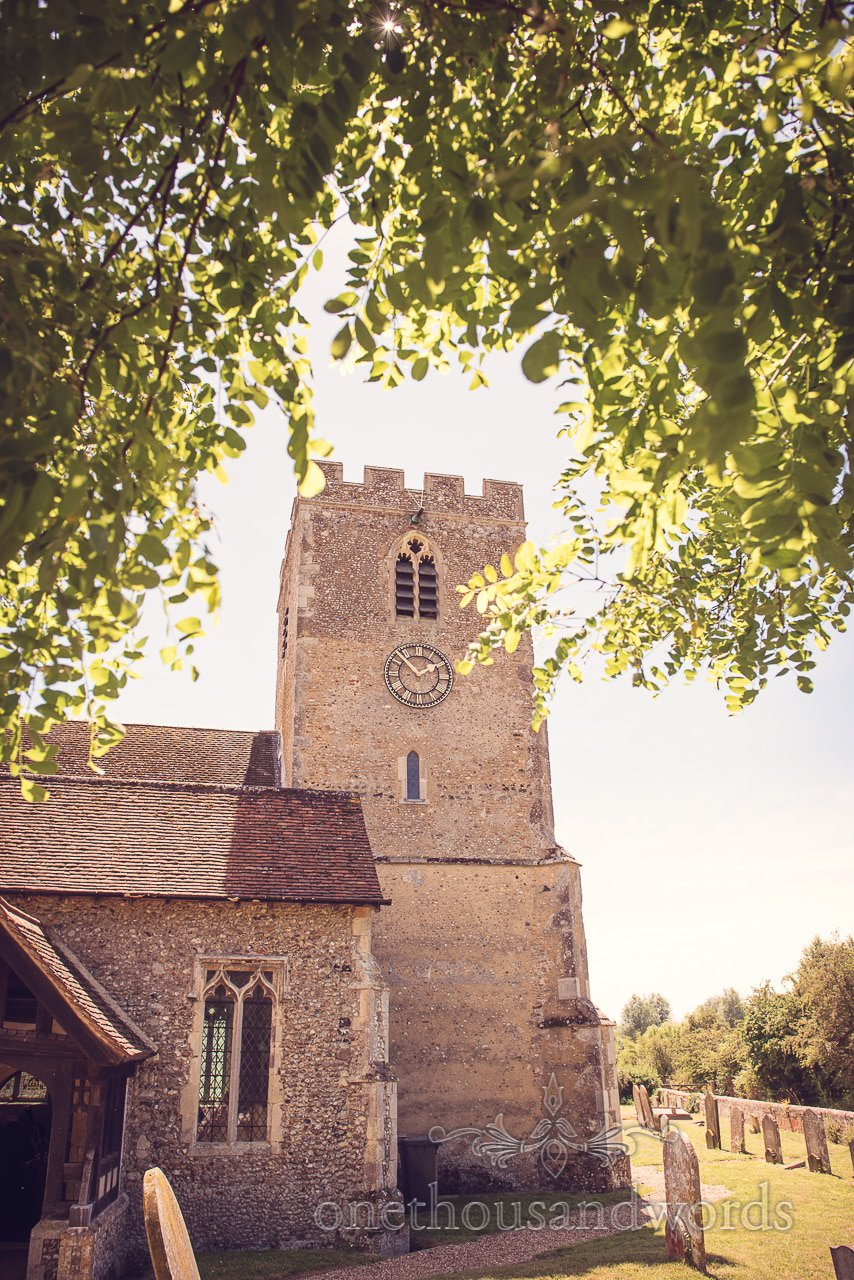 Church tower trough trees at Countryside Manor House Wedding