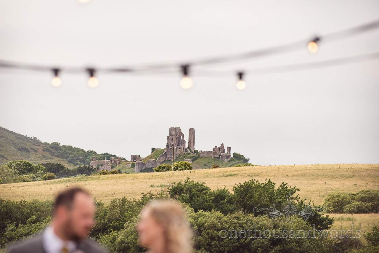 Corfe castle in the background of Purbeck Valley Farm Wedding Photographs