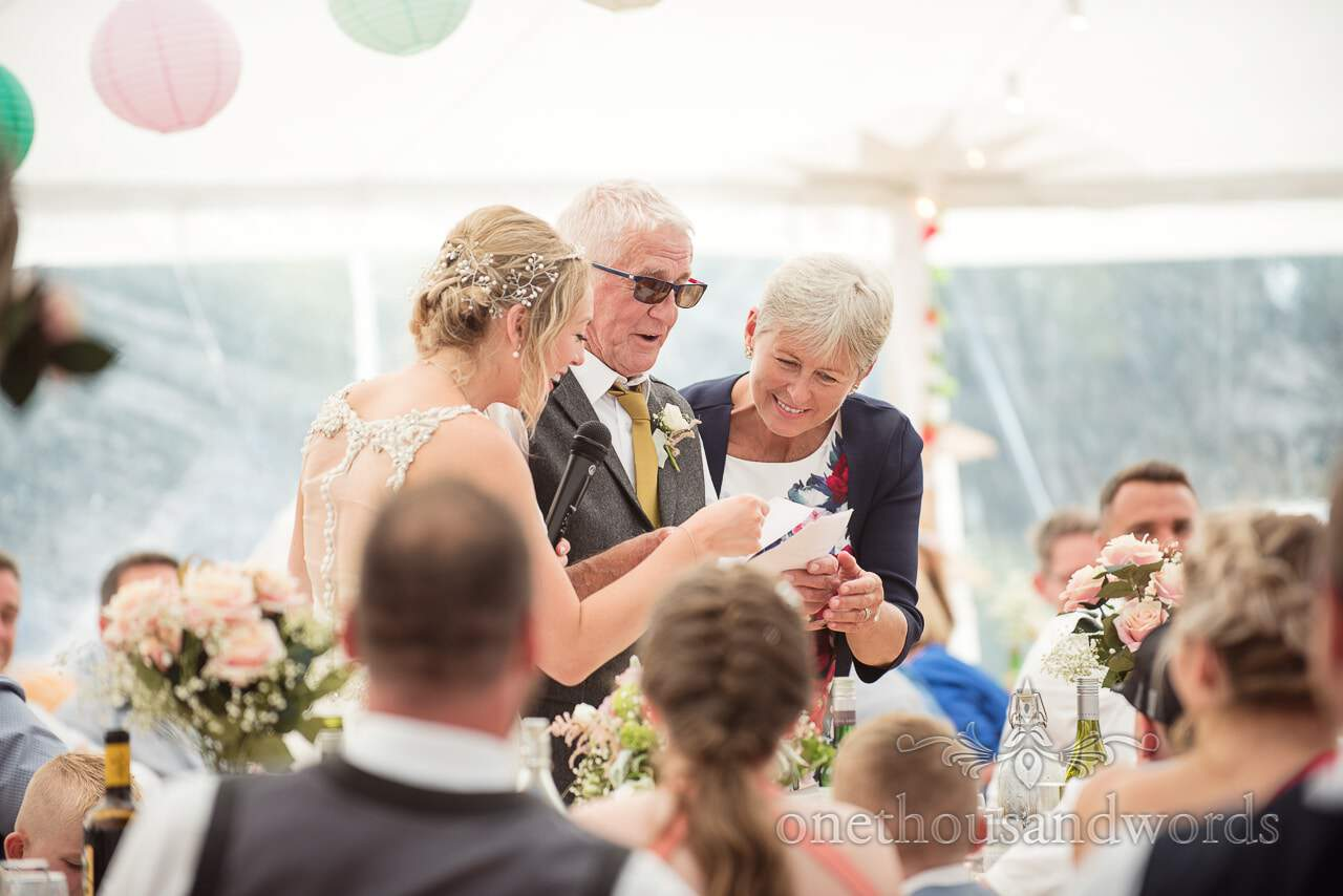 Daughter and wife help with father of the brides speech from Purbeck Valley Farm Wedding Photographs
