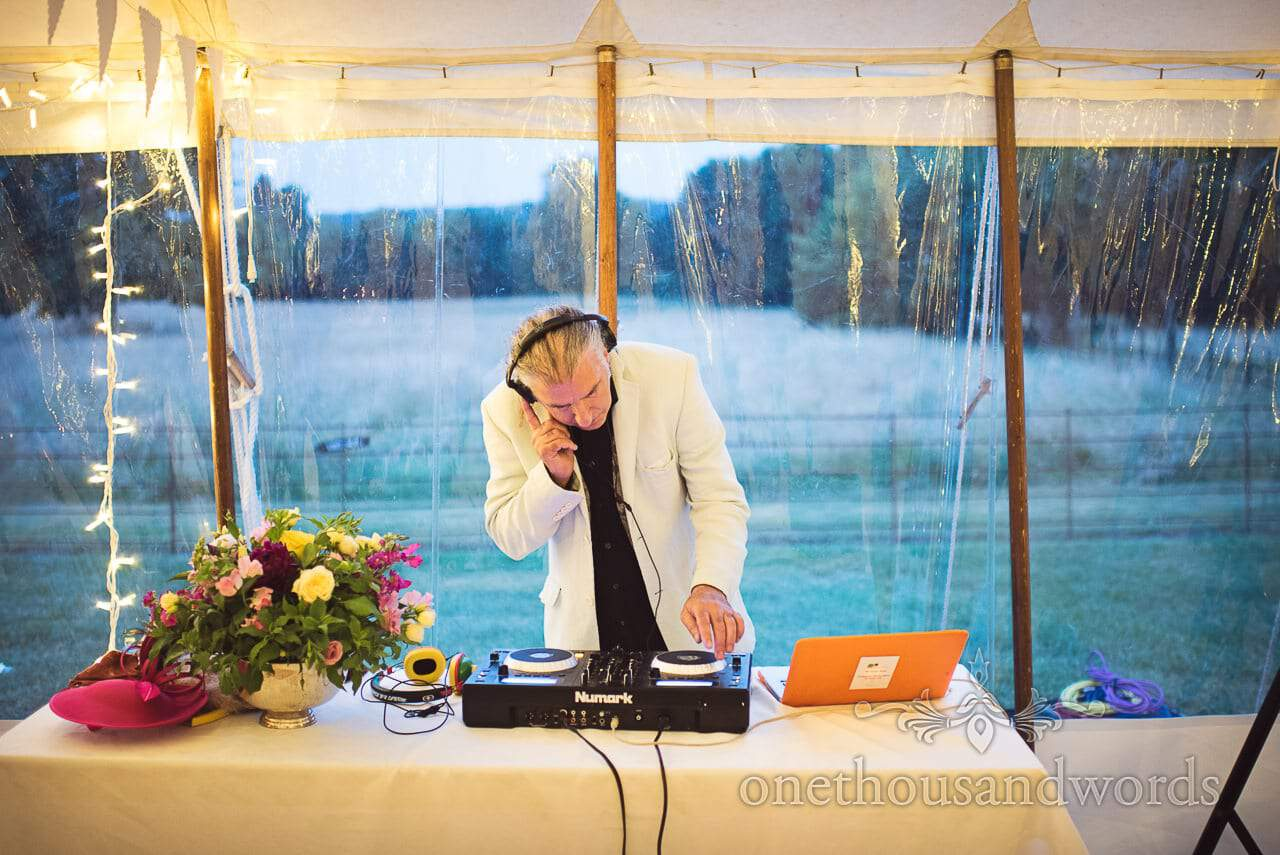 DJ mixes inside wedding marquee during reception countryside wedding