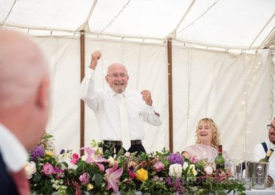 Father of the bride punches the air during speech at Countryside Manor House Wedding
