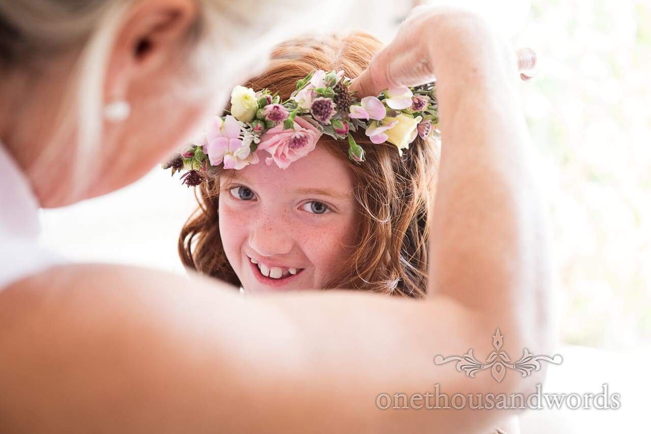 Flower girl has flower crown fitted from Countryside Manor House Wedding