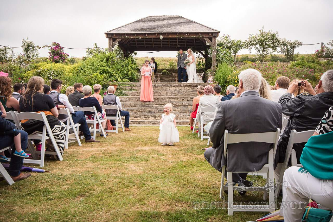 Flower girl in the aisle during ceremony from Purbeck Valley Farm Wedding Photographs