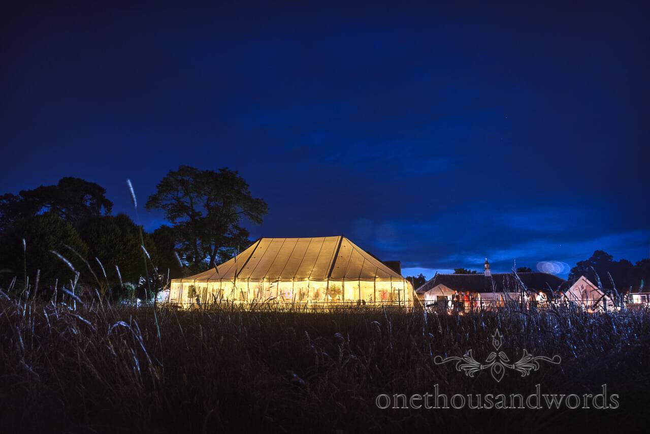 Glowing marquee on the lawn at Countryside Manor House Wedding