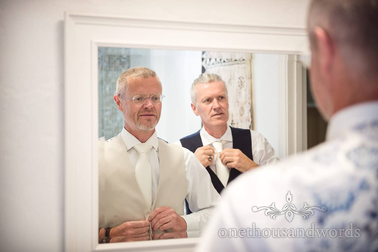 Groom and best man in mirror before Countryside Manor House Wedding