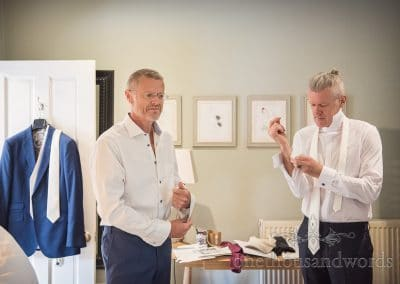 Groom and best man prepare themselves for Countryside Manor House Wedding