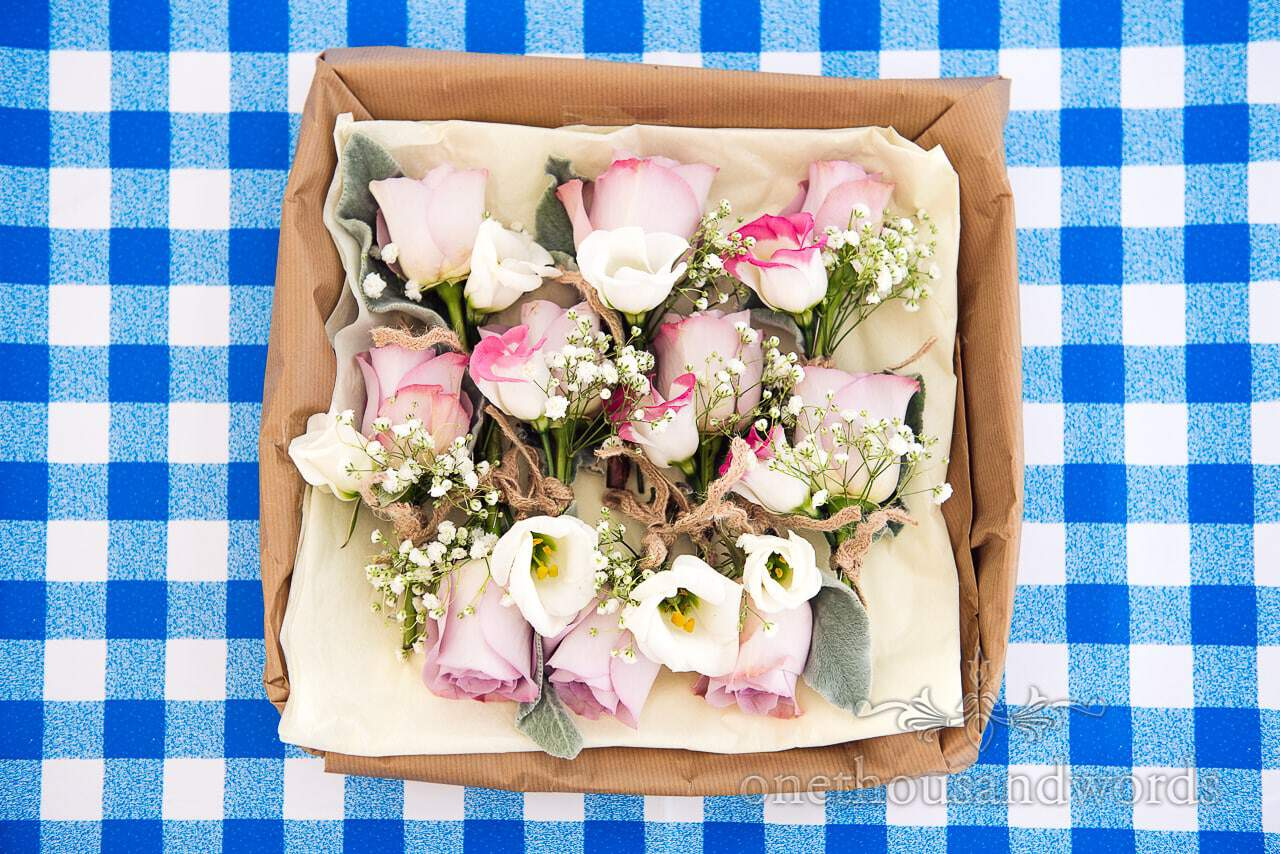 Groom and groomsmen buttonholes in box from Purbeck Valley Farm Wedding Photographs