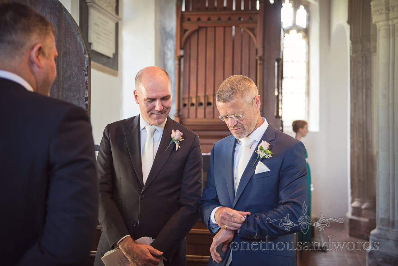 Groom checks his watch in church from Countryside Wedding