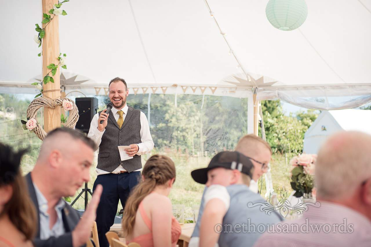 Grooms speech in marquee at Purbeck Valley Farm Wedding Photo
