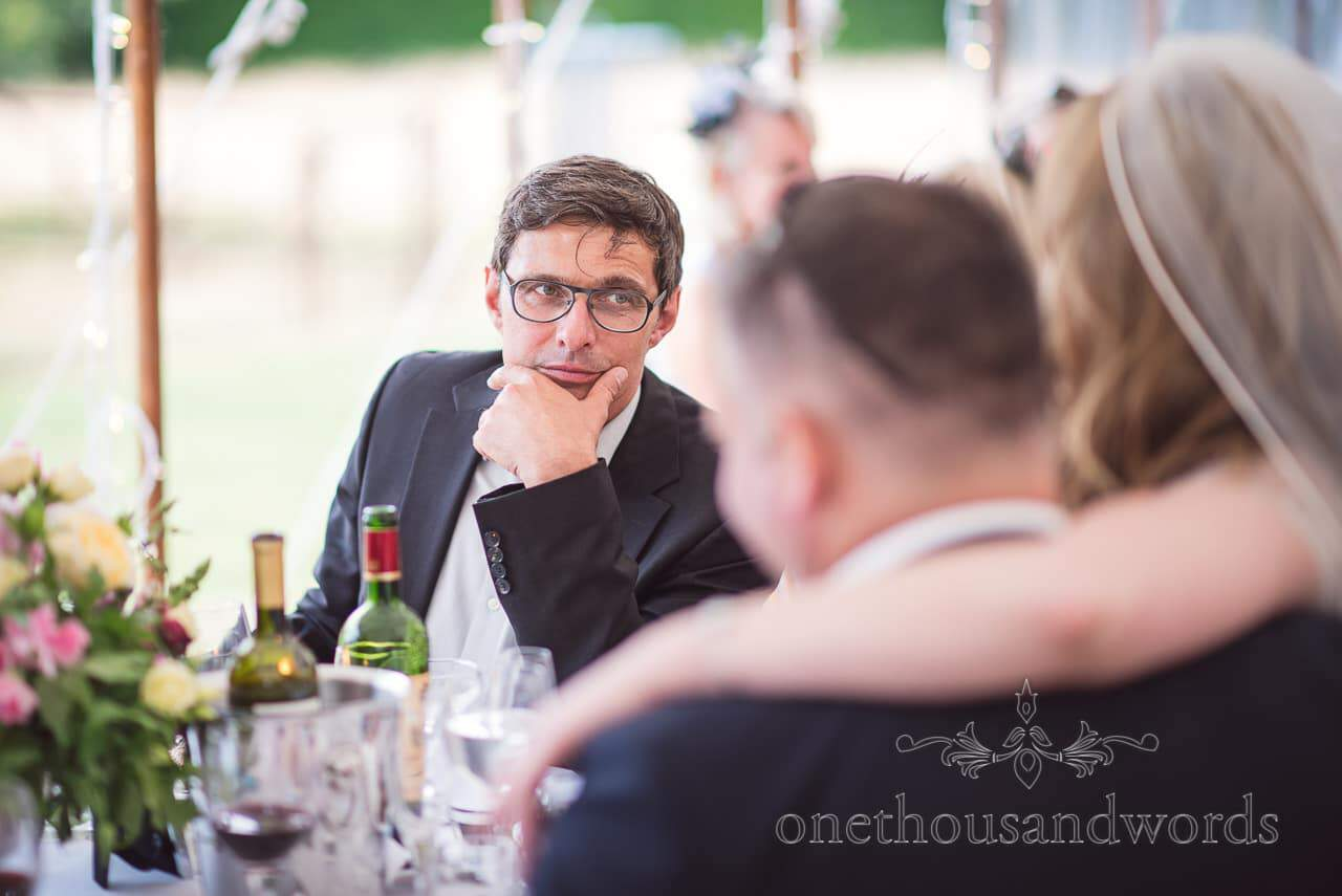 Guest in glasses during reception at countryside wedding