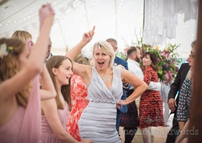 Guest strikes a pose during dancing at Countryside Manor House Wedding
