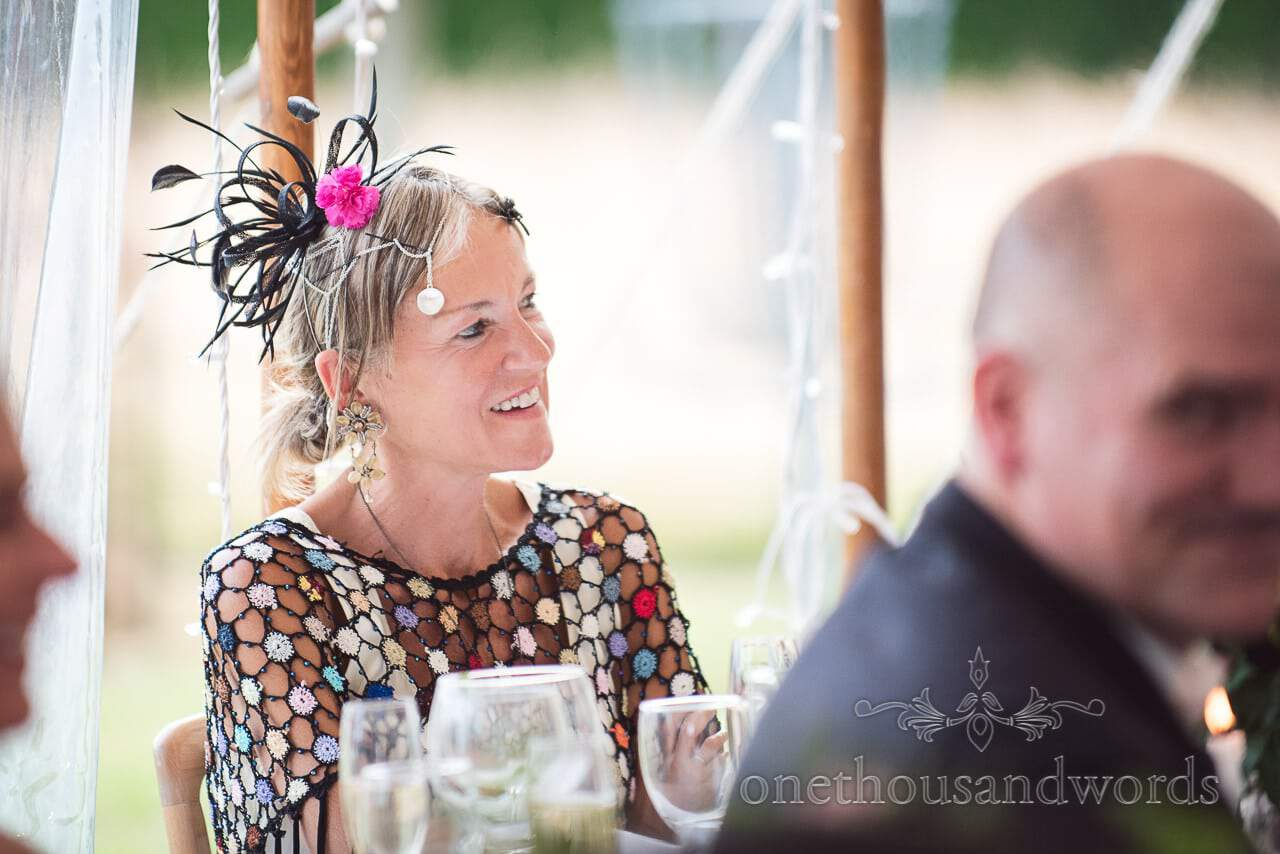 Guest with bright pink and black facinator at Countryside Manor House Wedding