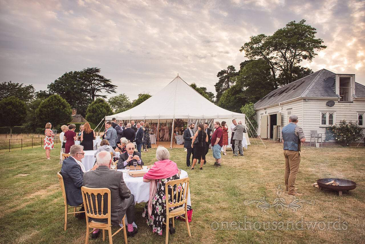 Guests enjoy sunny evening at Countryside Manor House Wedding