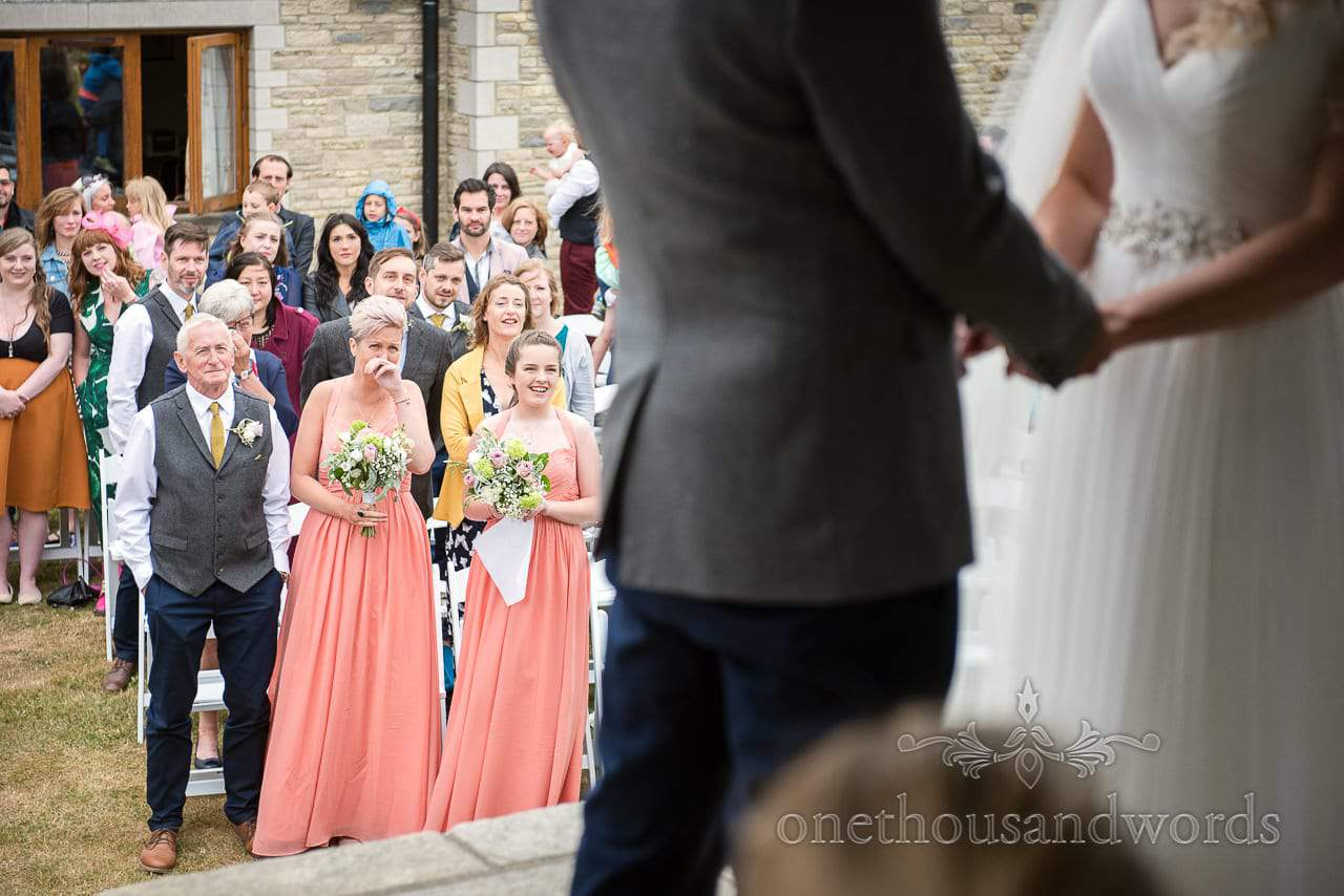 Guests look on during outdoor ceremony at Purbeck Valley Farm Wedding Photographs