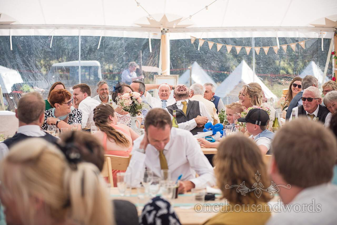 Laughter during speeches at Purbeck Valley Farm Wedding Photographs