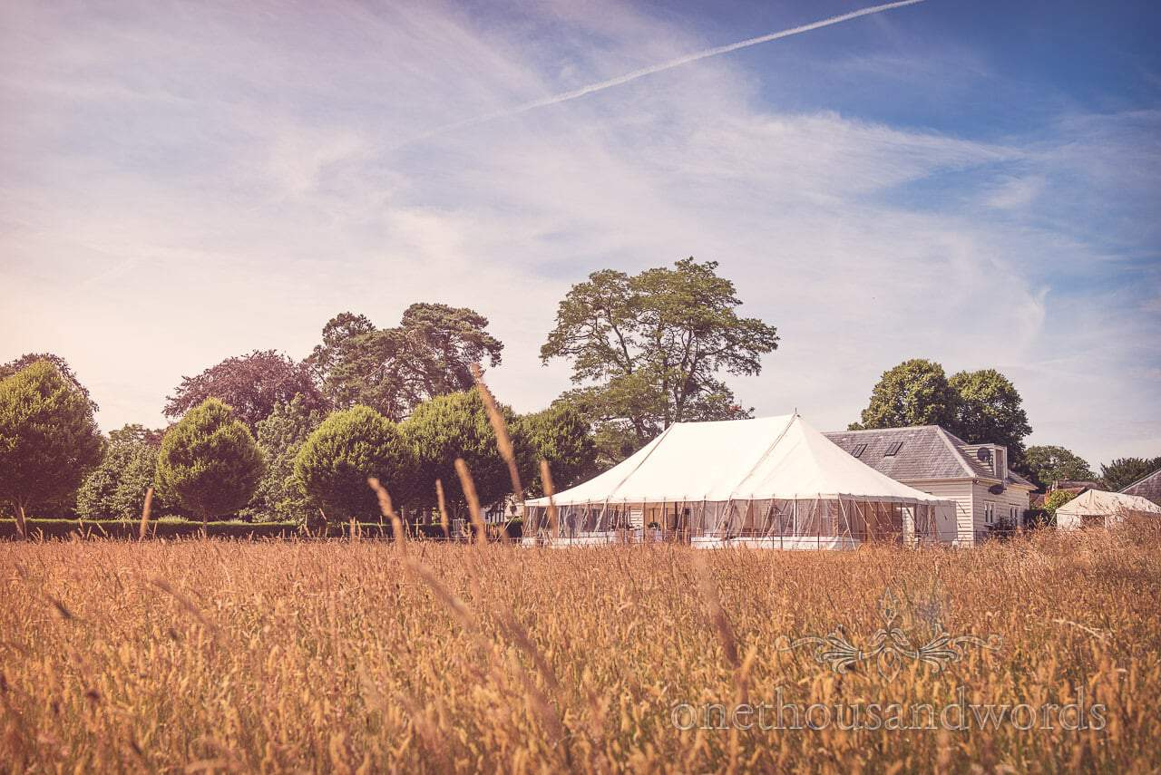 Marquee across field at Countryside Manor House Wedding