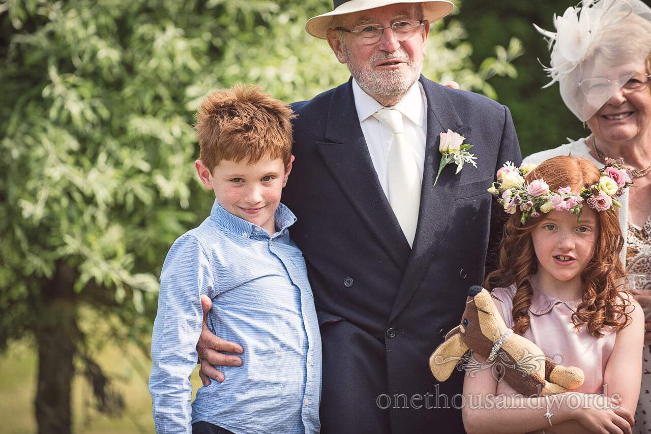 Mother and father of the bride with grandchildren at countryside wedding