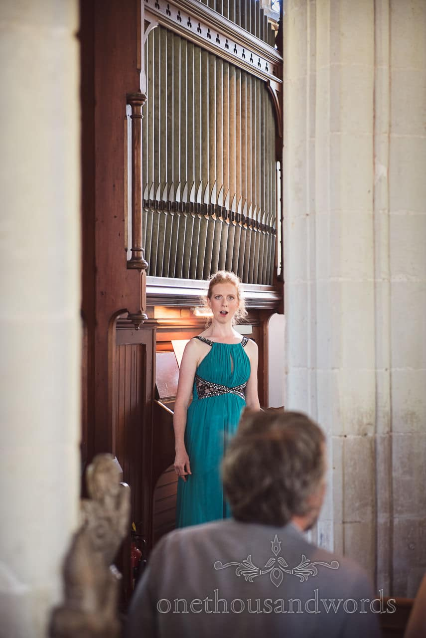 Opera singer sings in church from countryside wedding