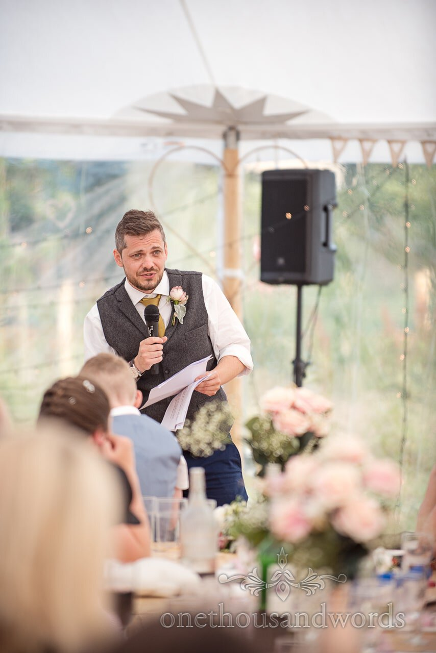 Purbeck Valley Farm Wedding Photographs of best man delivering speech