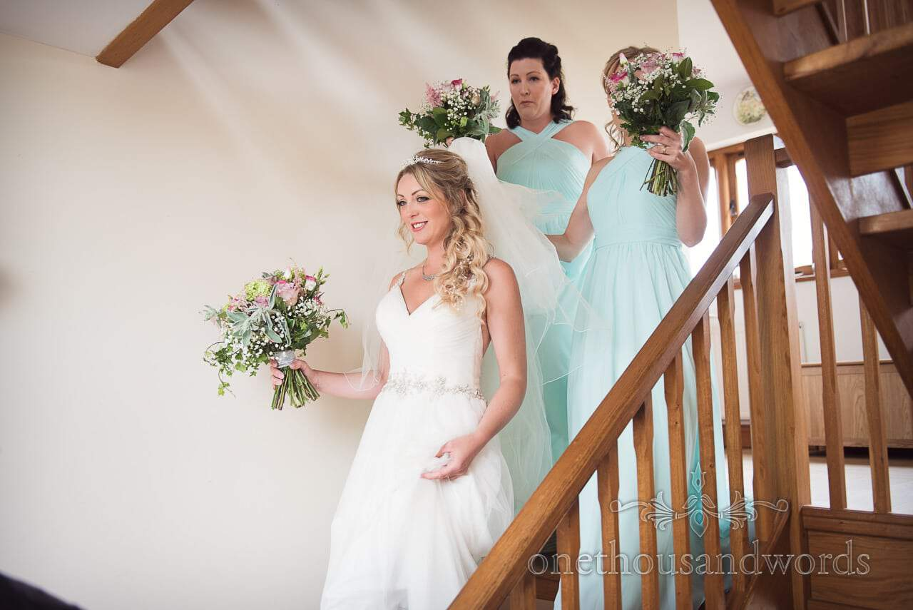 Purbeck Valley Farm Wedding Photographs of bride and bridesmaids ascending the stairs