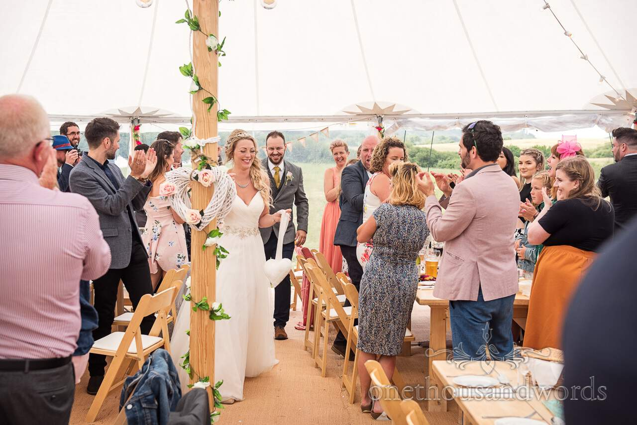 Purbeck Valley Farm Wedding Photographs of bride and groom entering marquee reception