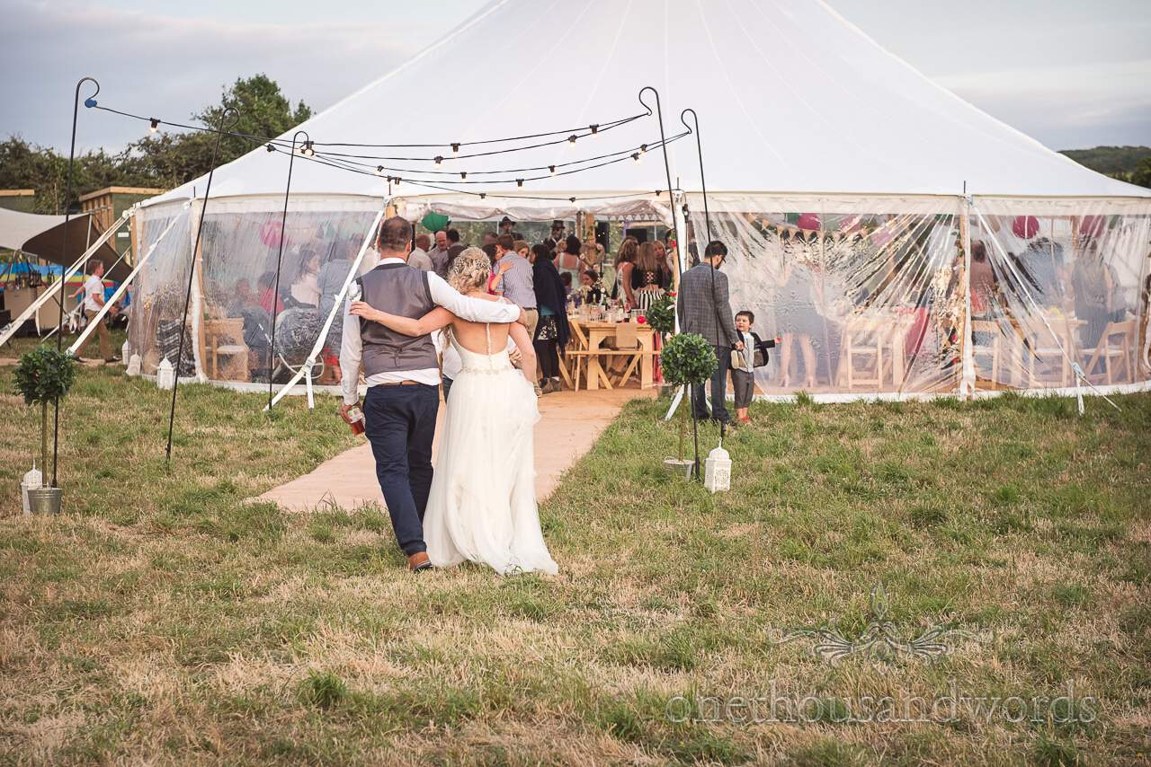 Purbeck Valley Farm Wedding Photographs of bride and groom returning to marquee