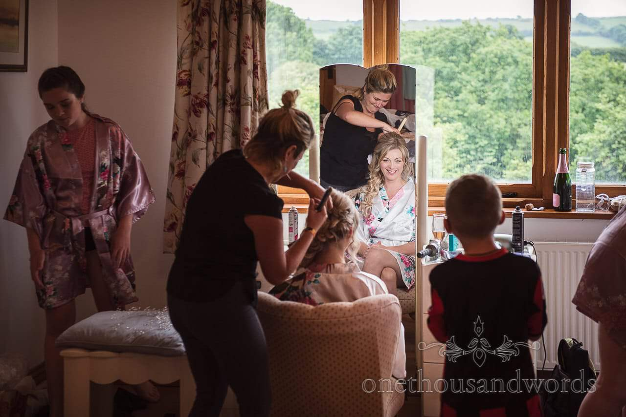 Purbeck Valley Farm Wedding Photographs of bride having hair styled
