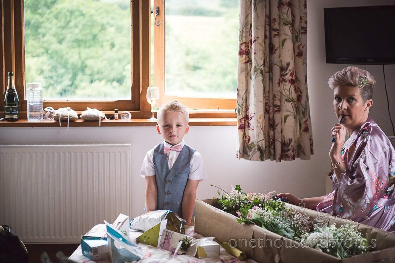 Purbeck Valley Farm Wedding Photographs of bridesmaid and page boy during preparations