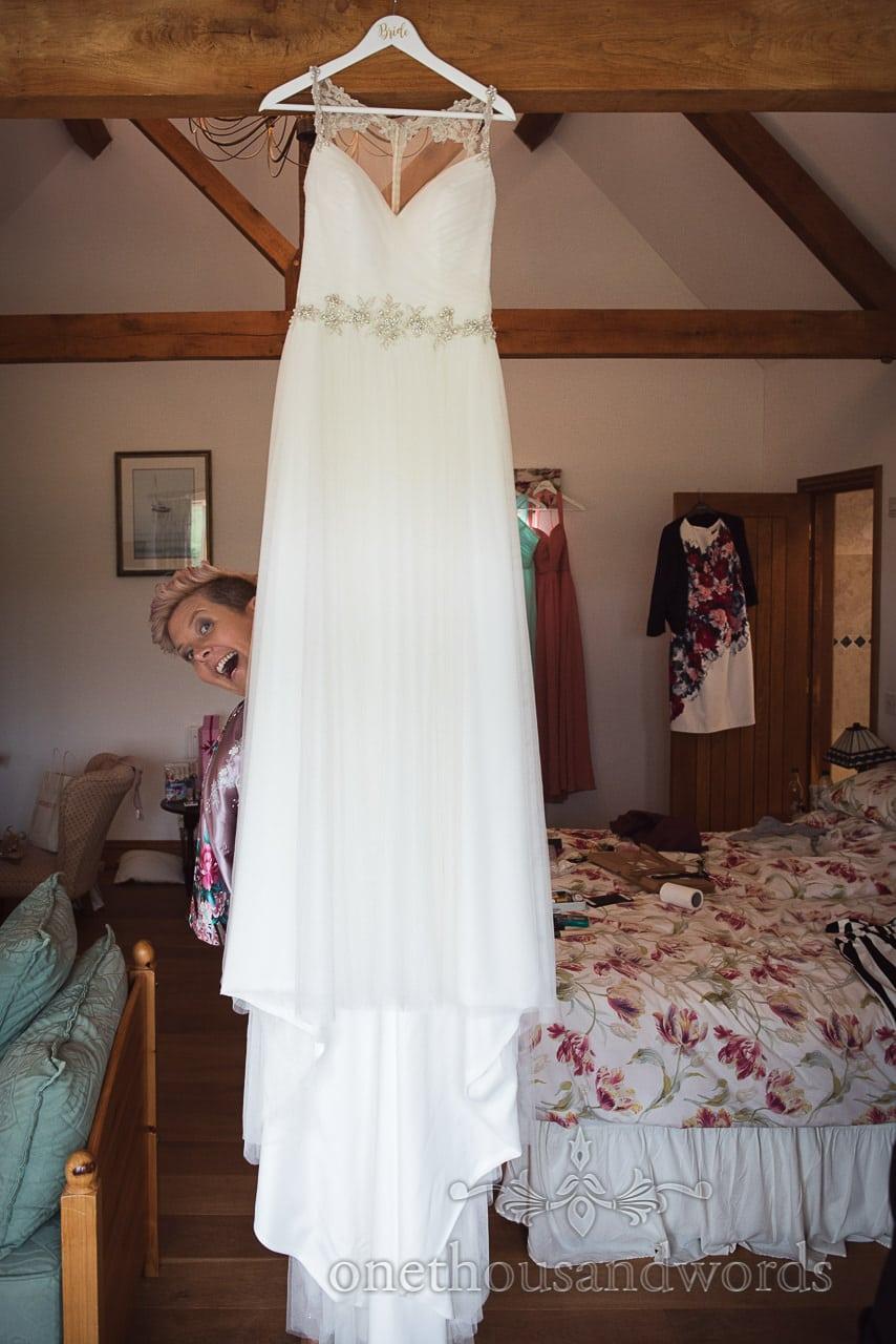 Purbeck Valley Farm Wedding Photographs of bridesmaid behind white wedding dress